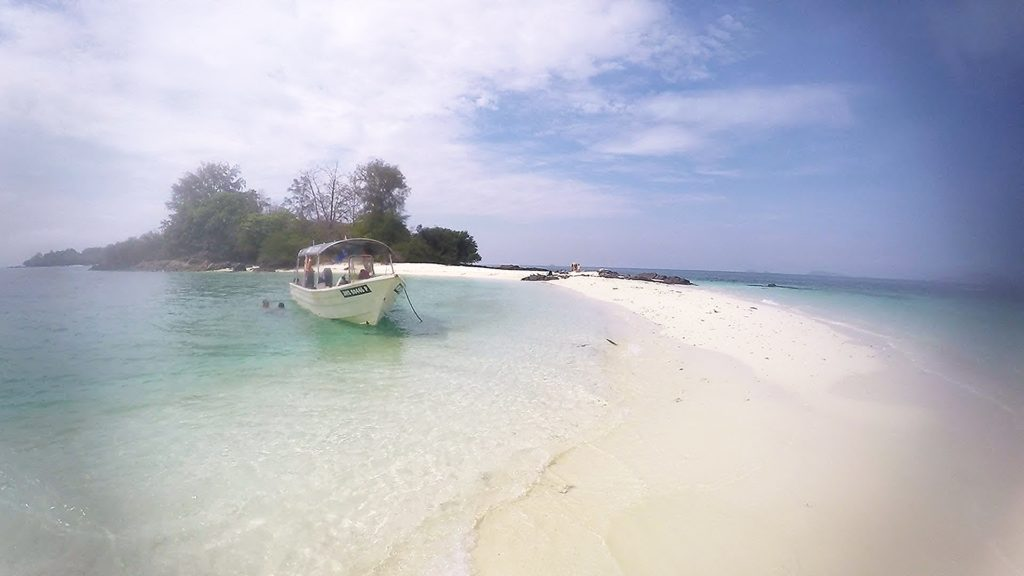 Crescent-shaped beach of Mentinggi